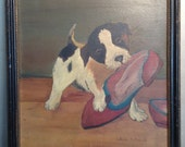 Antique oil painting on board of puppy with slipper in black and gold frame