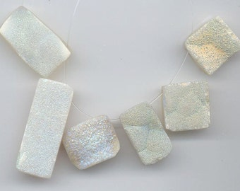 Six druzy/drusy chalcedony pendants with subtle shimmer