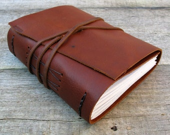 "Leather journal, C. S. Lewis quote, ""You can never get a cup of tea large enough, or a book long enough to suit me,"" / 320 pages"