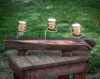 Reclaimed wood copper wired candle holder.
