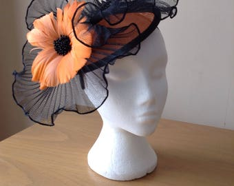 Black and Orange Sinamay Fascinator with a wave of pleated crin with a feather flower on a Band Weddings Races, Royal Ascot,Kentucky Derby