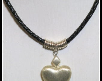 Sterling Silver Heart Pendant on plaited leather neck lace. Brushed Silver. Diamond. Matching Earrings. Silver Clasp. One of a Kind Handmade