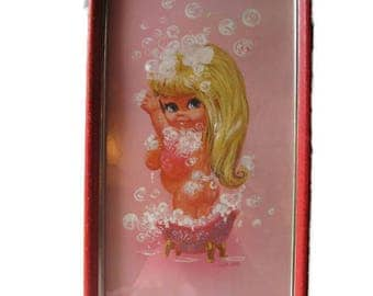 vintage bathroom decor pink big eyed nude girl in a bubbly bathtub, red frame, 60's kitsch W. M. Otto