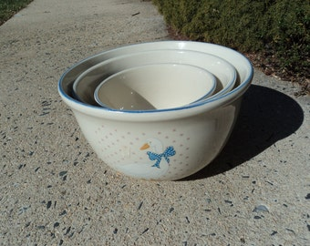 Three ceramic mixing bowls with country decor