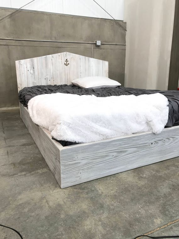 Kate bed. Weathered grey, white, and natural wood tones platform base with customize able cutout headboard; twin, full, queen,king