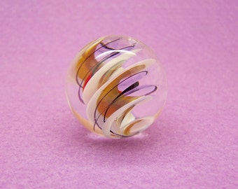 Fun large clear lampwork glass marble, swirled ribbons in white, black, red and amber suspended inside, flamework glass art marble