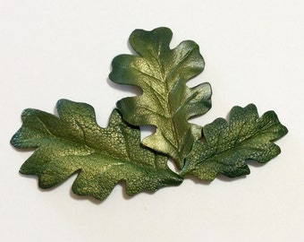 "Two 1.5"" shaded oak metallic leather leaves."