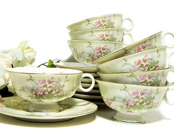Eight Theodore Haviland Apple Blossom Cups and Saucers