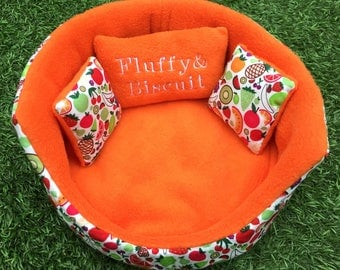SOLD! Small pet cuddle cup. Made-to-order in a range of patterns and fleece fabrics, with or without a name on cushion.