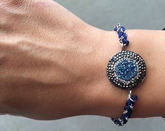 Silver chain bracelet braided with blue thread
