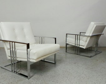 pair mid century modern Milo Baughman chrome white leatherette cantilever lounge chairs