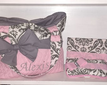 Personalized Diaper Bag In Pink & Grey Damask.  Add On Changing Pad And Wipes Case.  Interchangeable Bow Sash Around The Bag.