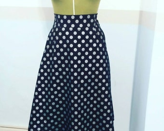 Fabulous black skirt with silver spots. Fully lined with cool pockets. UK size 16 us size 12.