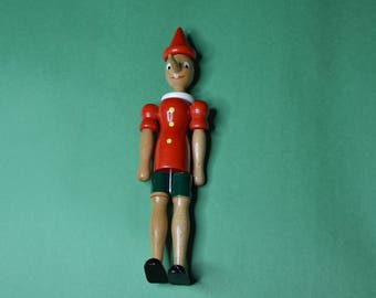 """A Vintage Wooden Pinocchio Figure That is 10"""" Tall"""
