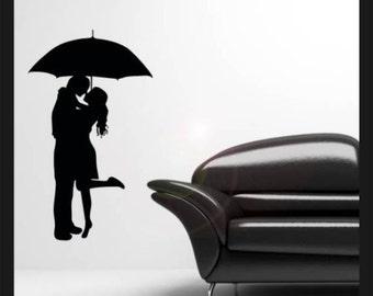 Kissing couple under an umbrella vinyl wall decal sticker