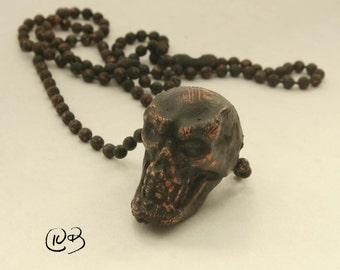 Copper electroform skull necklace.