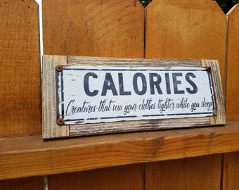 """Recycled wood framed """"Calories"""" metal street sign"""