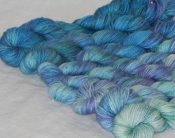 Winter Fantasy set of 7 mini skeins on Mad Sock Sparkle 75/20/5 SW merino nylon and stellina fingering yarn