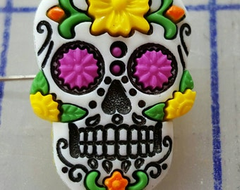 "Day of the dead (dia de los muertos)  buttons.  Wounderful detail.  3 per set.  Red, yellow, blue.   1"" tall.  Shank button.  Sugar skull"