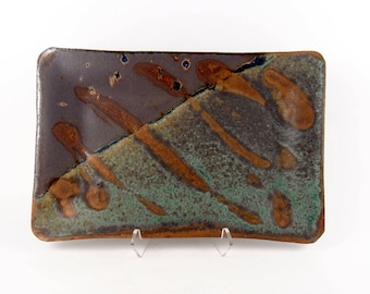Rectangular tray in sea green and eggplant purple with rutile accents and straight edges