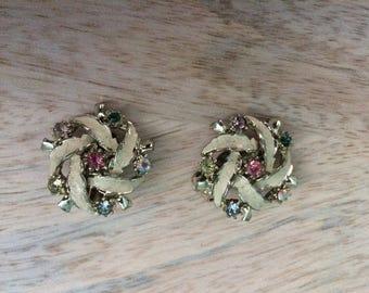 Rhinestone and enamel pinwheel clip on earrings
