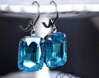 Aqua Blue Rhinestone Leverback earrings in an antique silver setting