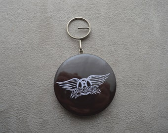"bottle opener and keychain ""Aerosmith"" round is 5.8 cm"