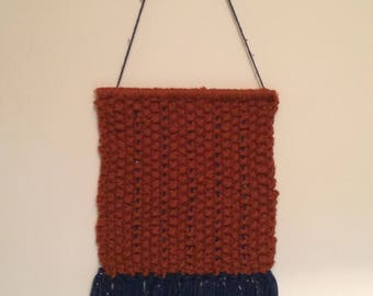Hand knitted wall hanging