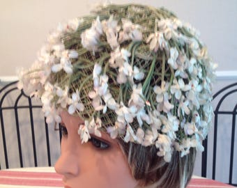 Vintage hat, flowers with stems on green netting, circa 1960