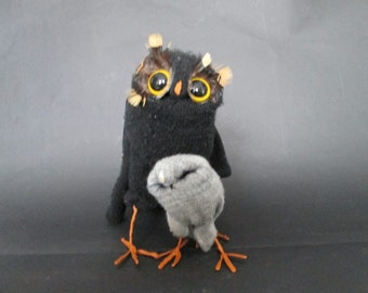 OWL with ninny of three found gloves