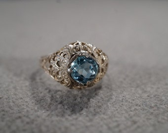 vintage sterling silver solitaire ring with large round faceted blue topaz with beautiful filigree setting, size 7  M1