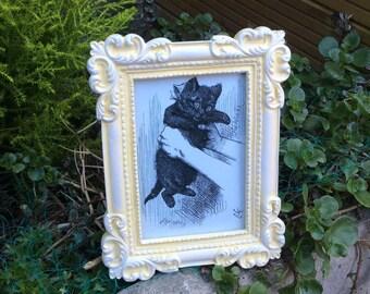 Stylish vintage Alice In Wonderland black cat within an elegant lemon photograph frame