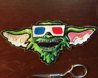 Movie theater Gremlin Sew-on patch 5.5x3in.