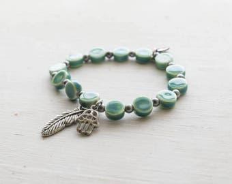 Blue glass beaded Hamsa and Feather  Stretch Bracelet