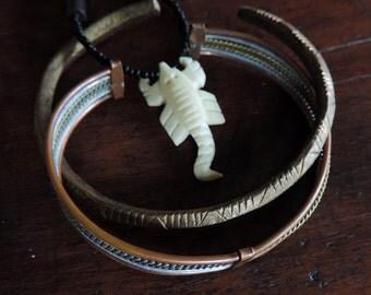 Scorpion pendant and 2 Masai bracelets for men.