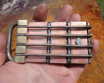 Bass fretboard belt bucke