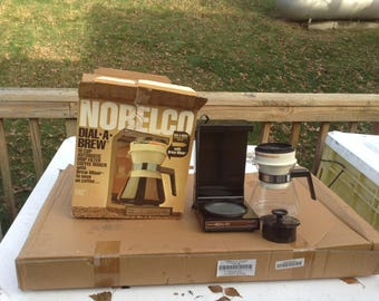 Vintage 1970's Norelco Dial-A-Brew 10-Cup Electric Drip Coffee Maker Clean. Works. Good condition.In the original box.