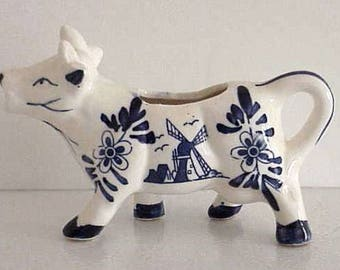 Hand Painted Porcelain Cow Creamer Delft Blue on White Dutch Windmill on one side Flower on other