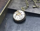 Brass round jeweled watch movement necklace. Handcrafted artistic steampunk jewelry -The Victorian Magpie
