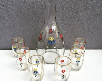 Hand painted pitcher and 6 glasses
