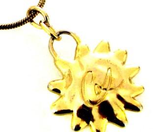 CHRISTIAN LACROIX, delightful vintage gold metal pendant