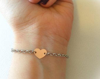Completely silver bracelet with heart bathed in gold rose