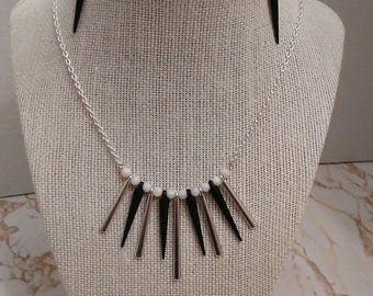 Black and white spike necklace with round shell beads on curb chain. Earrings included with necklace price