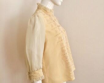 Vintage 1960s yellow chiffon blouse. Size 12. (ETS607)