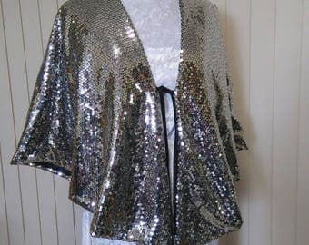 Silver sequinned cape