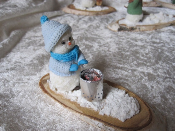 Snowman and his Brazier. Winter, holidays and mountain snow balls! Porcelain cold saeljana.