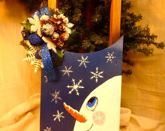 Hand painted snowman and snowflakes on small sled door hanger by Debbie Easley
