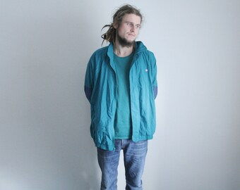 Vintage teal windbreaker jacket