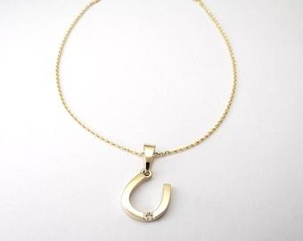Horseshoe gold 0.015 carat diamond pendant with necklace