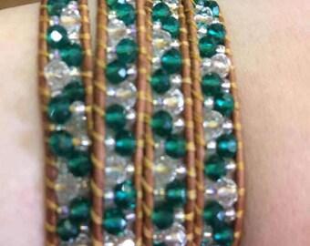 Turquoise beads on light brown wrap bracelet